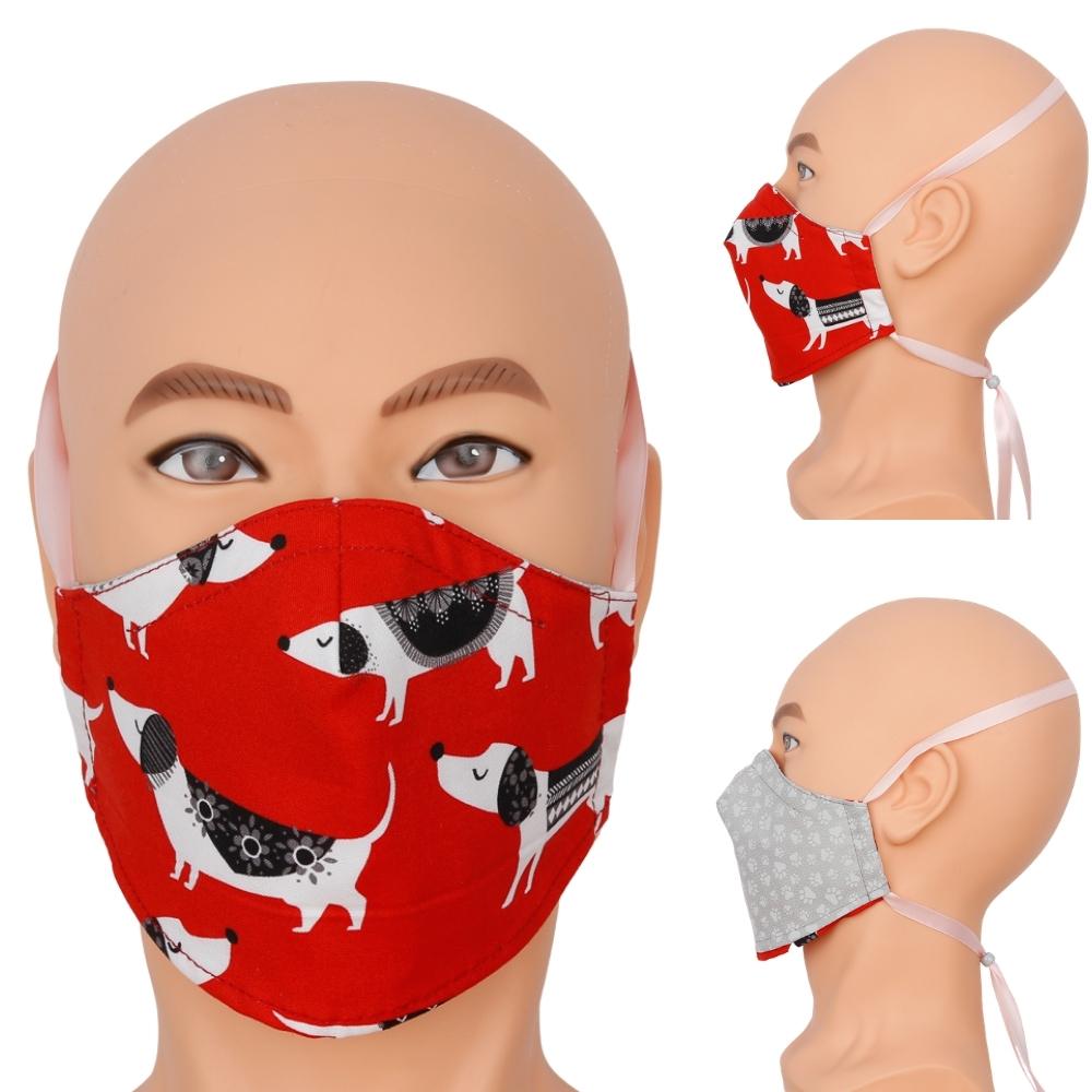 red face mask with black and white dog