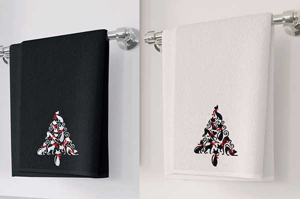 Black and white hand towels with holiday trees of cats