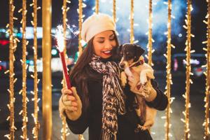 woman and dog outside celebrating