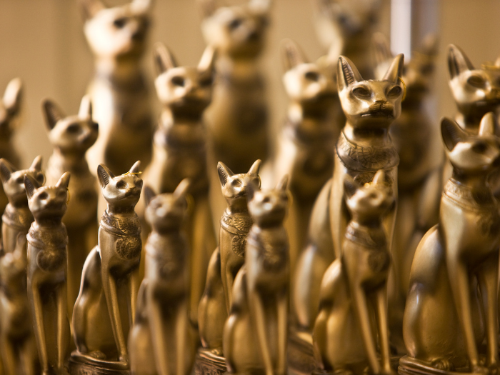 Gold Egyptian cat statues
