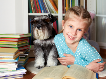 dog and girl with books